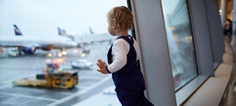 Child at the Airport Looking at Planes