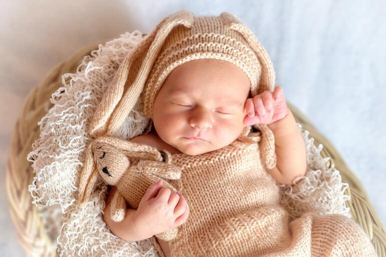 baby in rabbit costume is sleeping