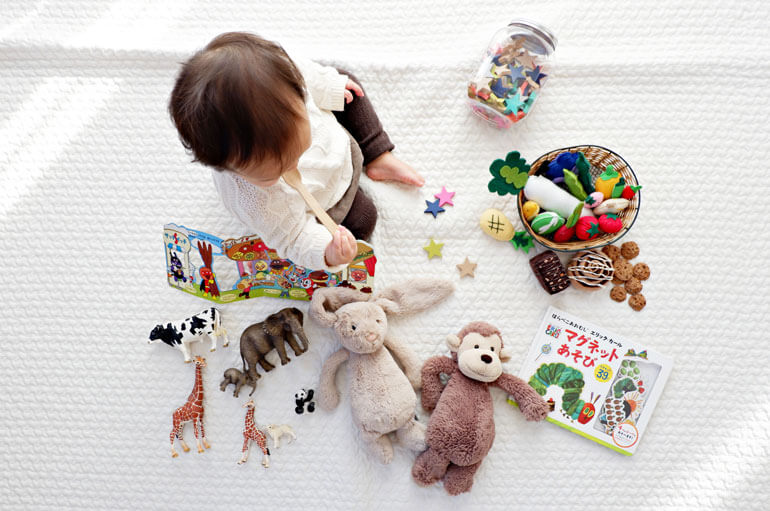 baby playing with animals